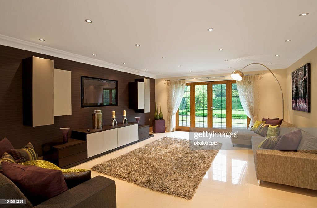 Modern Living Room Space With Purple Green And Brown Decor High Res Stock Photo Getty Images