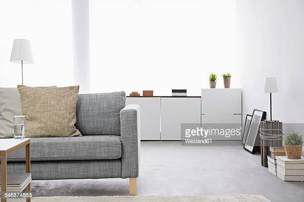 Modern living room with couch and sideboard