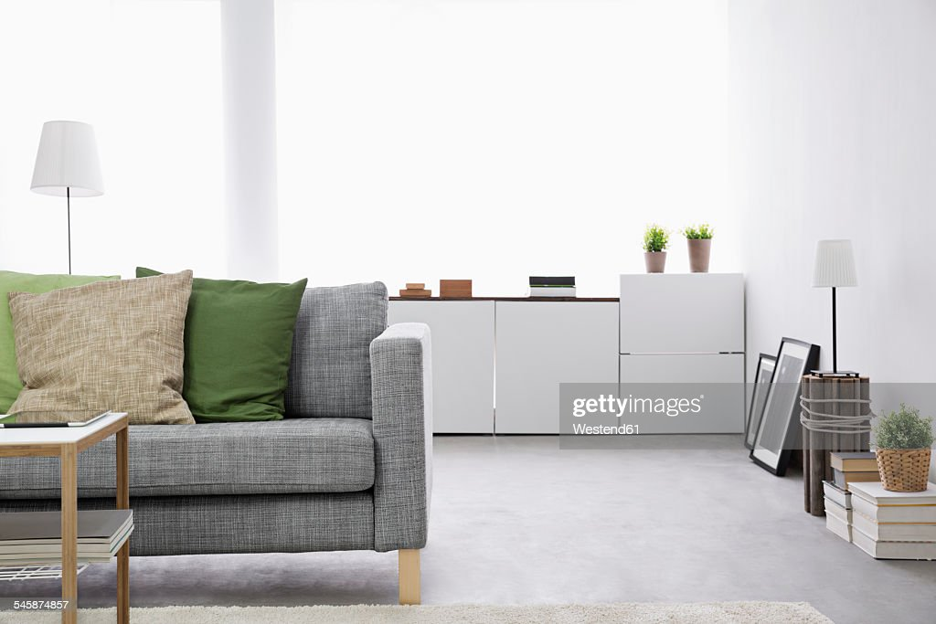 Modern living room with couch and sideboard : Stock Photo