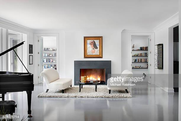 modern living room with fire place, chicago il - modern stock pictures, royalty-free photos & images