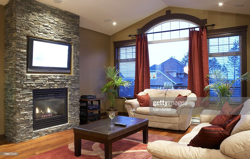 Modern Living Room With Fireplace And Flat Screen Television Stock Photo Getty Images