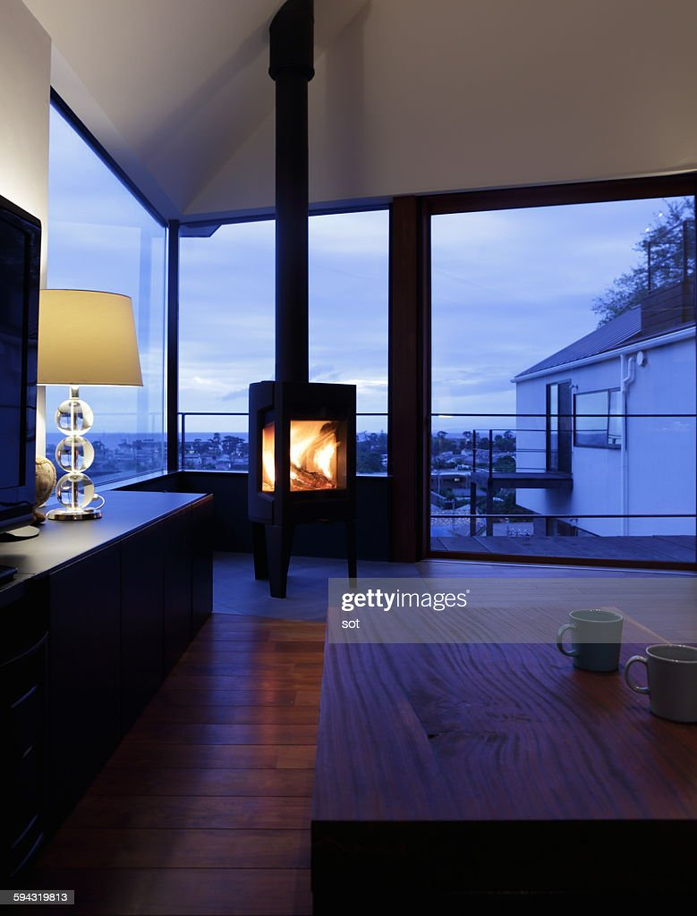 modern living room with fireplace at dusk ストックフォト getty images