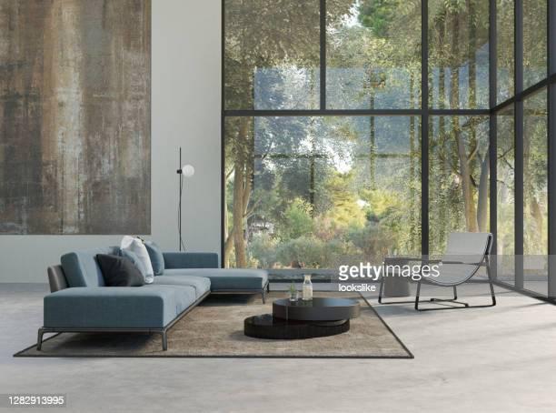 modernes wohnzimmer mit waldblick - gemaltes bild stock-fotos und bilder
