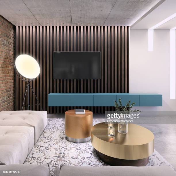 modern living room with large tv on the wall - art deco furniture stock pictures, royalty-free photos & images