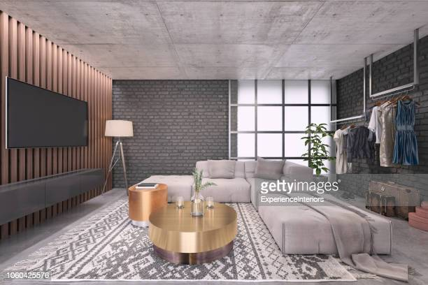 modern living room with large tv on the wall - colore bronzo foto e immagini stock