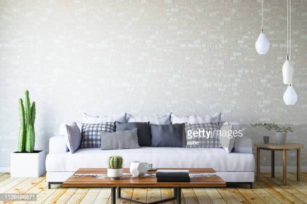 modern living room with sofa and decorations - living room wallpaper stock pictures, royalty-free photos & images