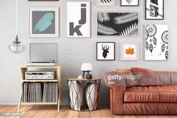 modern living room with sofa and frames - arts culture and entertainment stock pictures, royalty-free photos & images