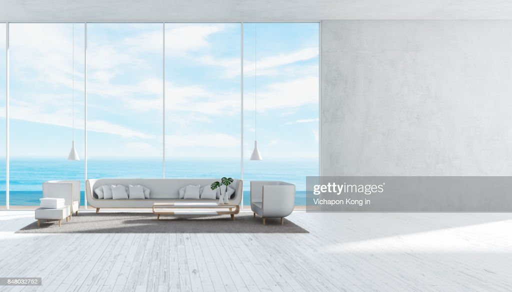 Modernes Wohnzimmer Mit Sofa Set Betonwand Panorama Meer Blick Sommer  3D Rendering : Stock