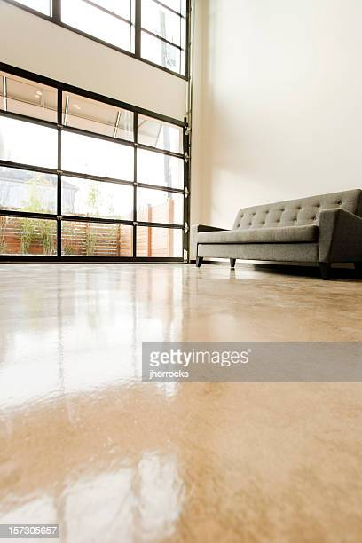 modern living space with polished concrete floor - flashing stock photos and pictures
