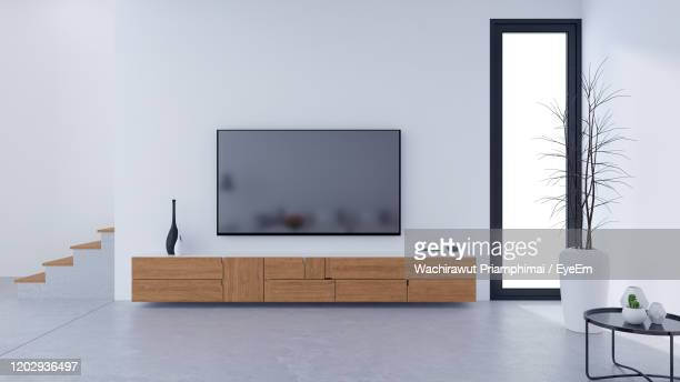 modern loft  tv cabinet design and cozy  style, - living room wallpaper stock pictures, royalty-free photos & images