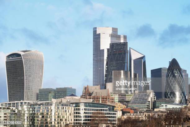 modern london architecture and skyline against sky - skyscraper stock pictures, royalty-free photos & images