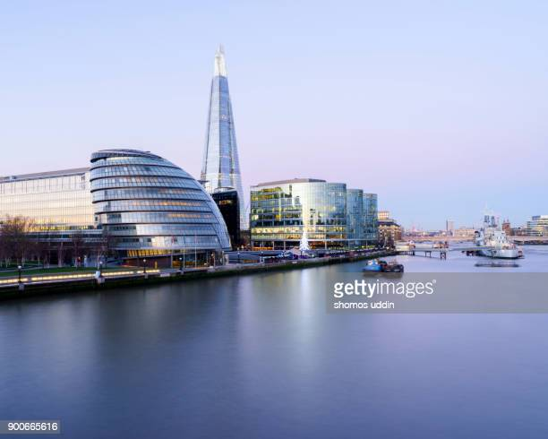 Modern London architecture and Southwark skyline, lit up at dawn