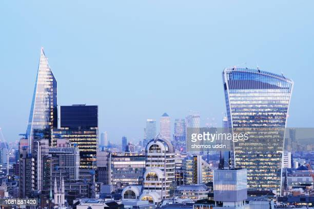 modern london skyline and the financial district at dusk - scalpel stock photos and pictures