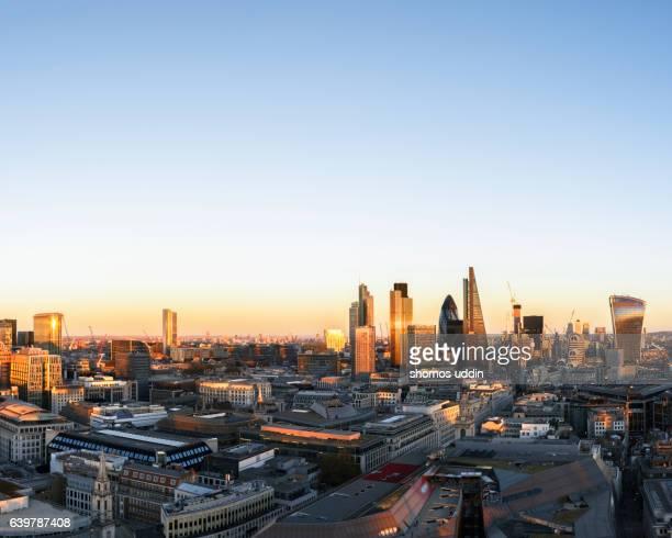 Modern London skyline at sunset