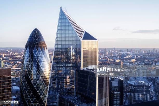 modern london skyscrapers against clear sky - day stock pictures, royalty-free photos & images