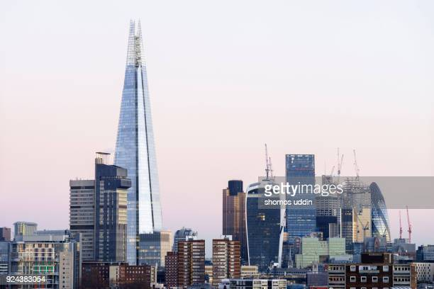 modern london skyscrapers and the financial district at dawn - shard london bridge stock pictures, royalty-free photos & images