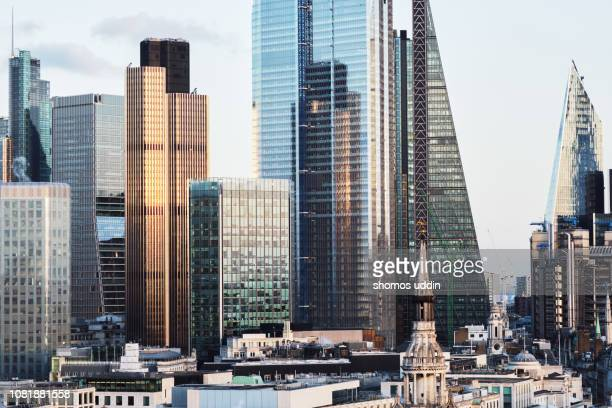 modern london skyscrapers and the financial district at sunset - london skyline stock pictures, royalty-free photos & images