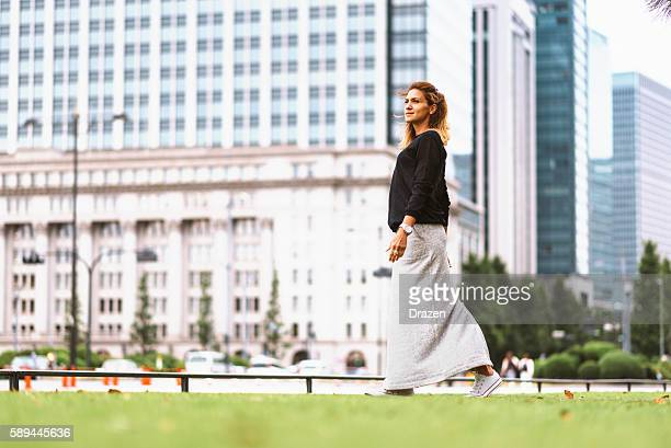 Modern looking woman in street fashion clothing in Tokyo