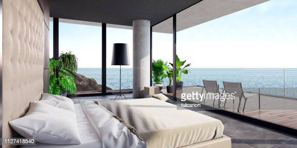 modern luxurious bedroom with large terrace in a villa by the ocean - luxury hotel stock pictures, royalty-free photos & images