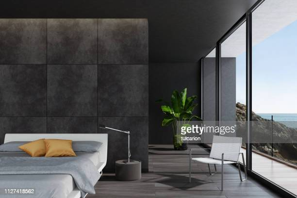 modern luxurious black bedroom in a villa by the ocean - penthouse stock pictures, royalty-free photos & images