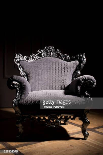 modern luxury armchair with silver lines and blue velvet textile in dark - throne stock pictures, royalty-free photos & images