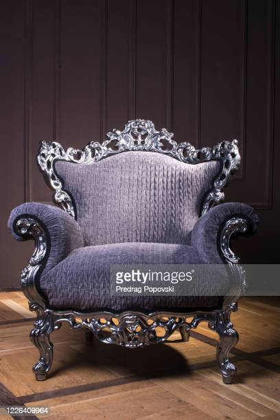modern luxury armchair with silver lines and violet velvet textile in dark - throne stock pictures, royalty-free photos & images