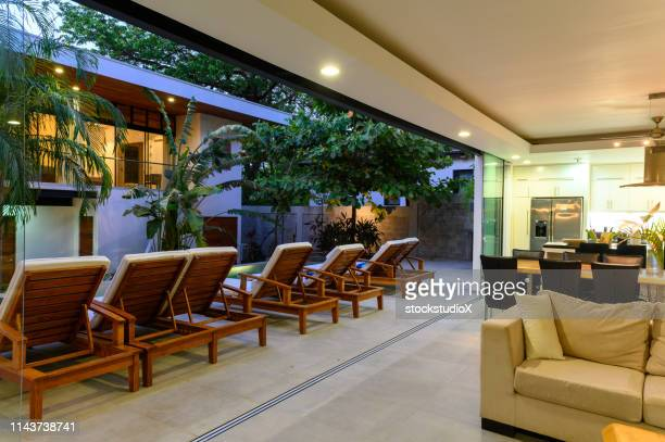 modern luxury home at dusk - patio doors stock pictures, royalty-free photos & images