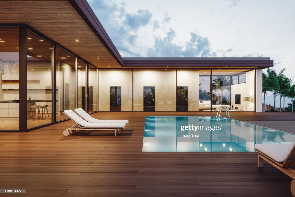 Modern Luxury House With Private Swimming Pool At Dusk : Stock Photo