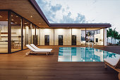 Modern Luxury House With Private Swimming Pool At Dusk