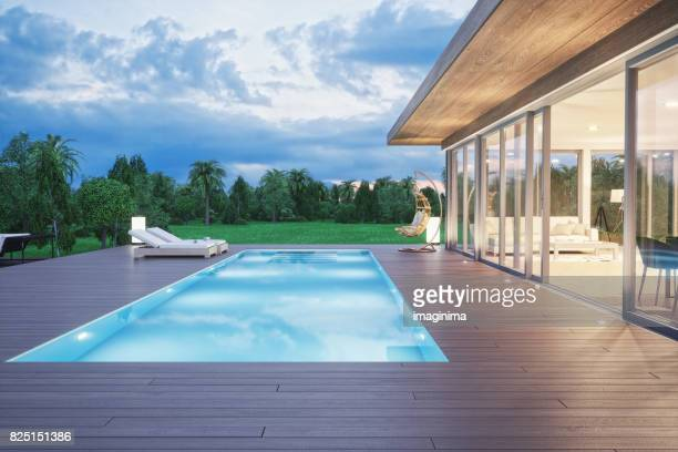 Modern Luxury House With Swimming Pool At Dawn