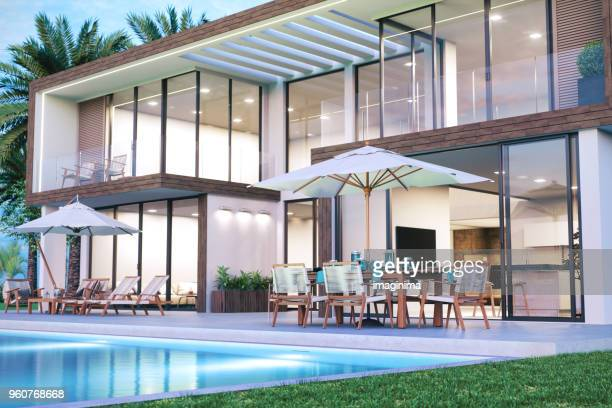 modern luxury house with swimming pool - luxury stock pictures, royalty-free photos & images