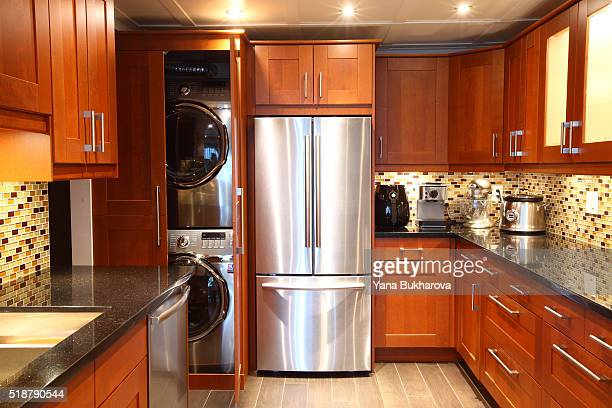 Modern luxury kitchen with built-in washer and dryer