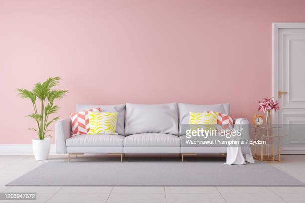 modern luxury living room interior design, gray sofa on black wall and concrete floor,3d rendering - new stock pictures, royalty-free photos & images