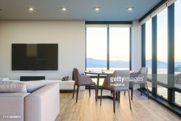 salon de luxe moderne avec vue sur l'océan au coucher du soleil - admirer le paysage photos et images de collection