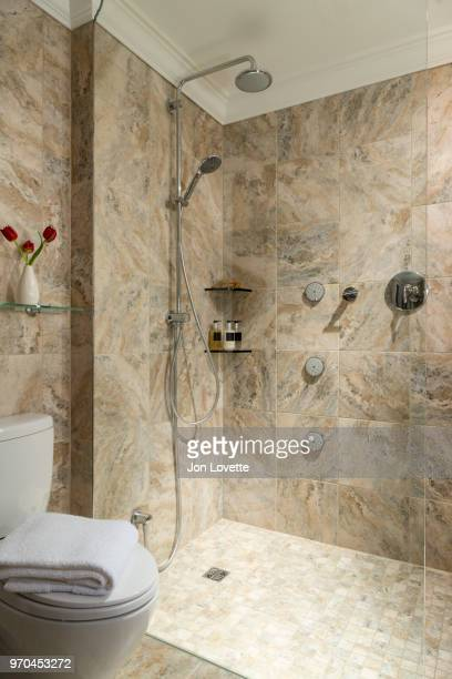 Modern Luxury Marble Bathroom with walk in shower fitted with many shower heads and Body Jets