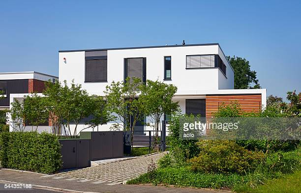 Modern luxury white house with front garden