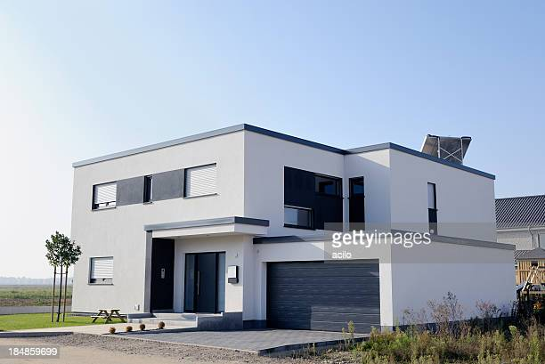 modern luxury white house with garage - house stock pictures, royalty-free photos & images