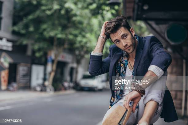modern man in city - modern manhood stock pictures, royalty-free photos & images