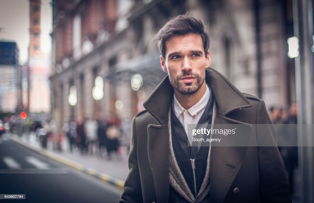 Modern man in winter coat : Stock Photo