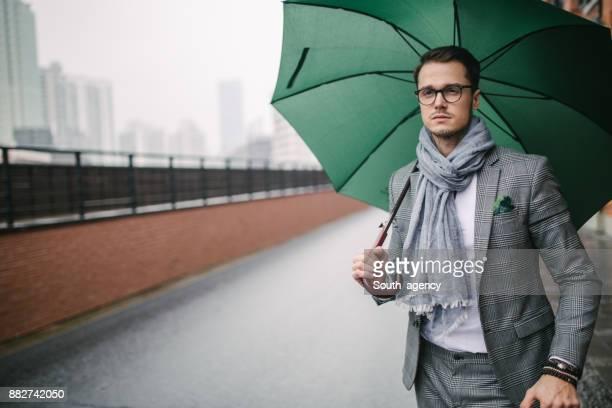 Modern man with umbrella