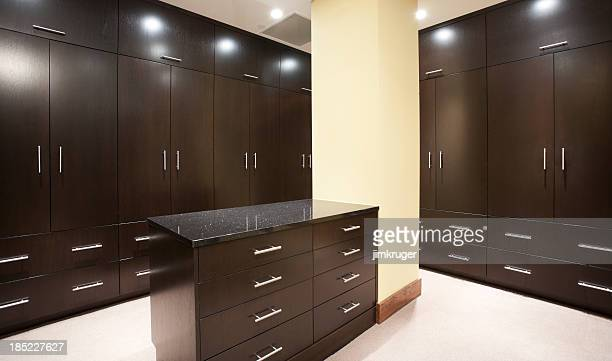 Modern master bedroom closet with dark stain.