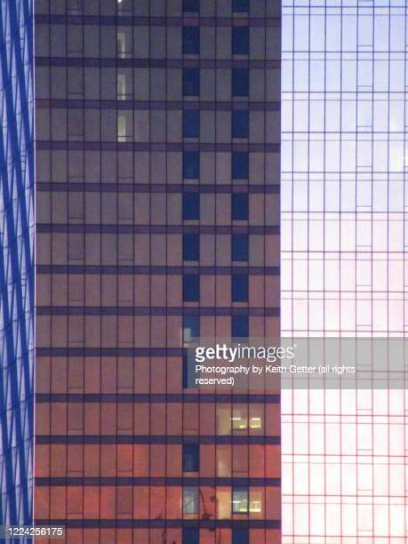 modern metal and glass skyscraper close-up detail at sunset - symbol stock pictures, royalty-free photos & images