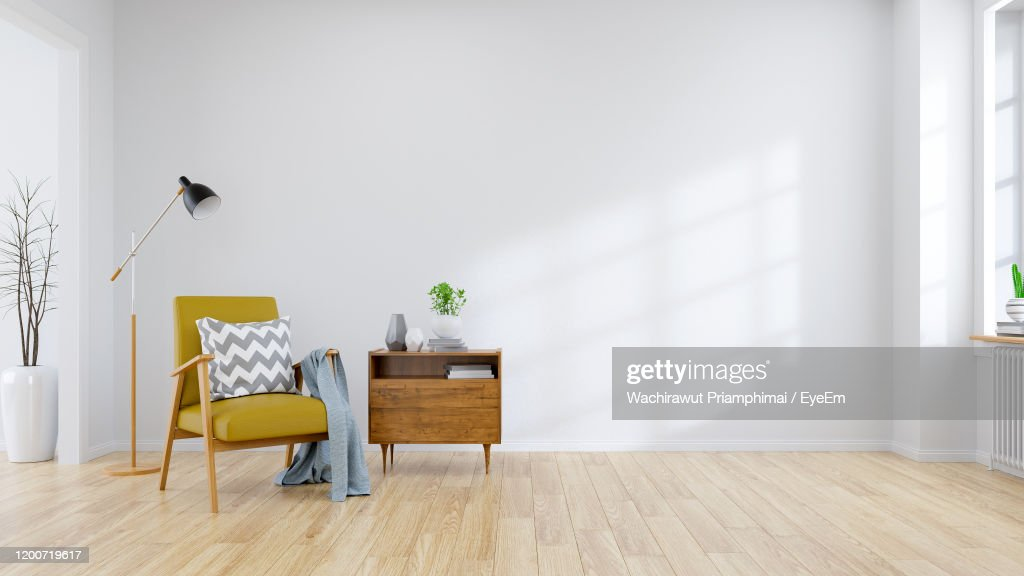 Modern Mid Century And Minamalist Interior Of Living Room Yellow Armchair With Wood Table : Stock Photo