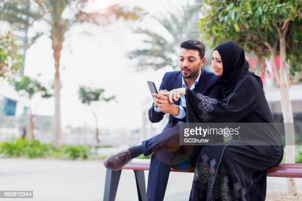 Modern middle eastern couple exploring social media on a smart phone