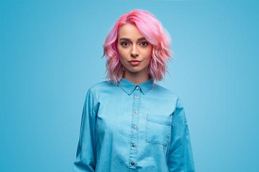 Modern millennial woman with pink hair 1140764346