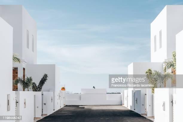 modern minimalism architecture, buildings details with blue sky. - isla de lanzarote fotografías e imágenes de stock