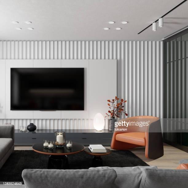 moderne minimalistische wohnung innenwohnzimmer mit 8k tv-bildschirm. - insight tv stock-fotos und bilder