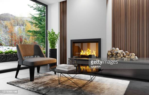 modern minimalist apartment interior living room with fireplace - stone material stock pictures, royalty-free photos & images