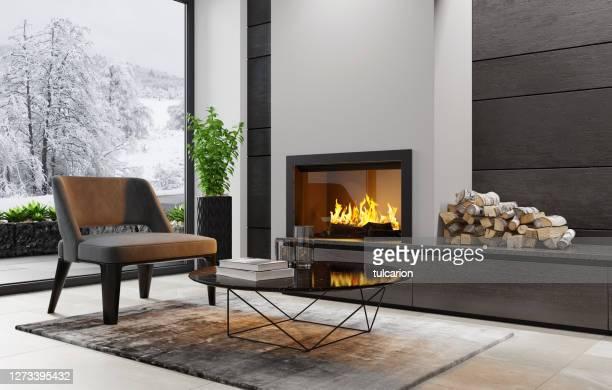 moderne minimalistische appartement interieur woonkamer met open haard - opwarmen stockfoto's en -beelden