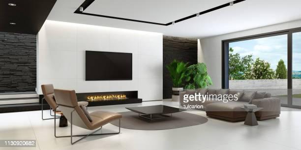 モダンでミニマルな黒と白のリビングルーム (エコ暖炉付) - insight tv ストックフォトと画像